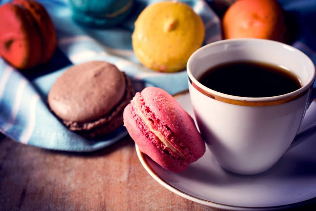 Macaroon cookies and cup of coffee,selective focus and low key