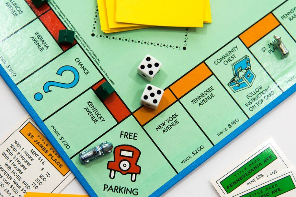 Houston, TX, USA - November 1, 2014: Monopoly board game - car on Free Parking and dice