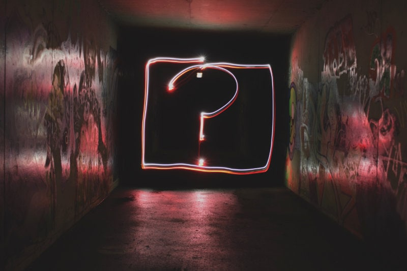 a neon question mark sign