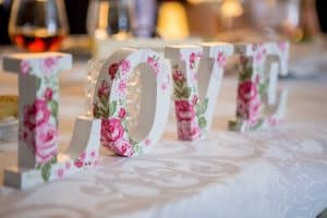 "Letter Blocks Making Up the Word ""L-O-V-E"" at a wedding reception desk"