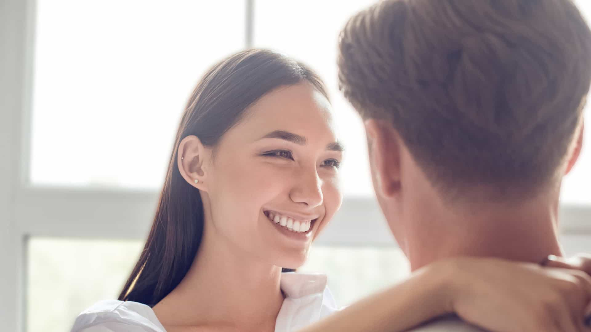 Dating agency: woman smiling at man