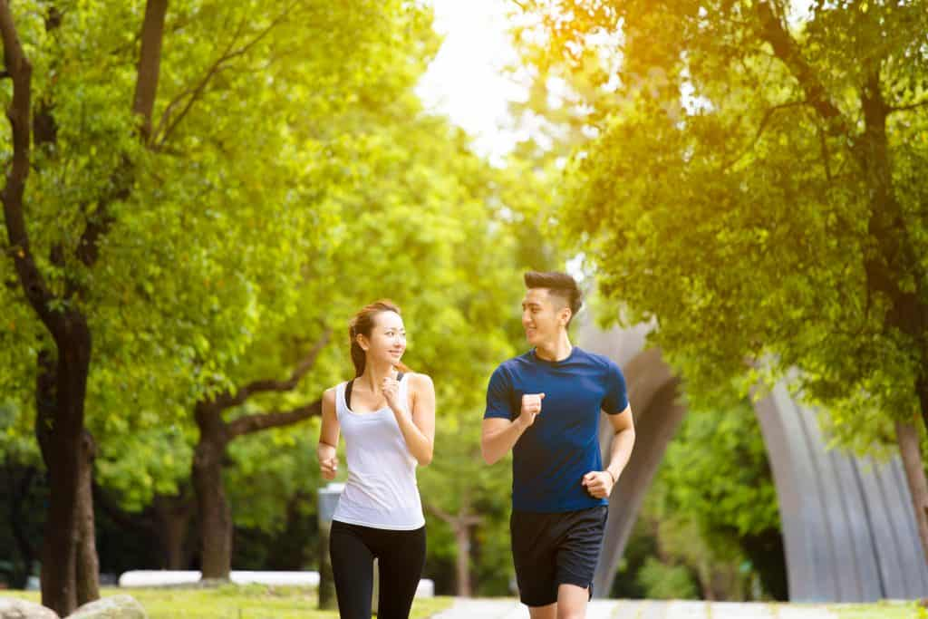 man and woman jogging togethe