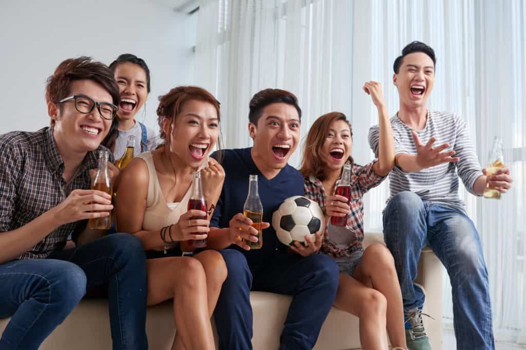 a group of friends watching soccer match together