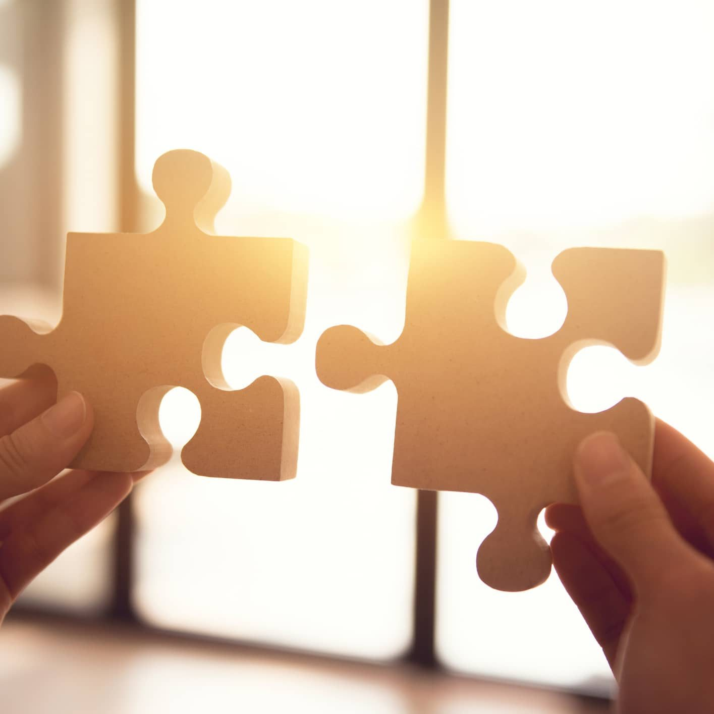 Silhouette of woman connecting jigsaw puzzle with sunlight effect, Business solutions, success and strategy concept.